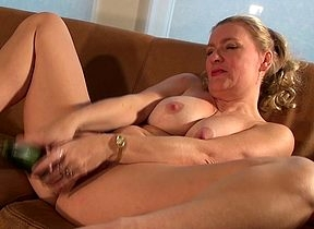 Sweltering housewife riding a cucumber
